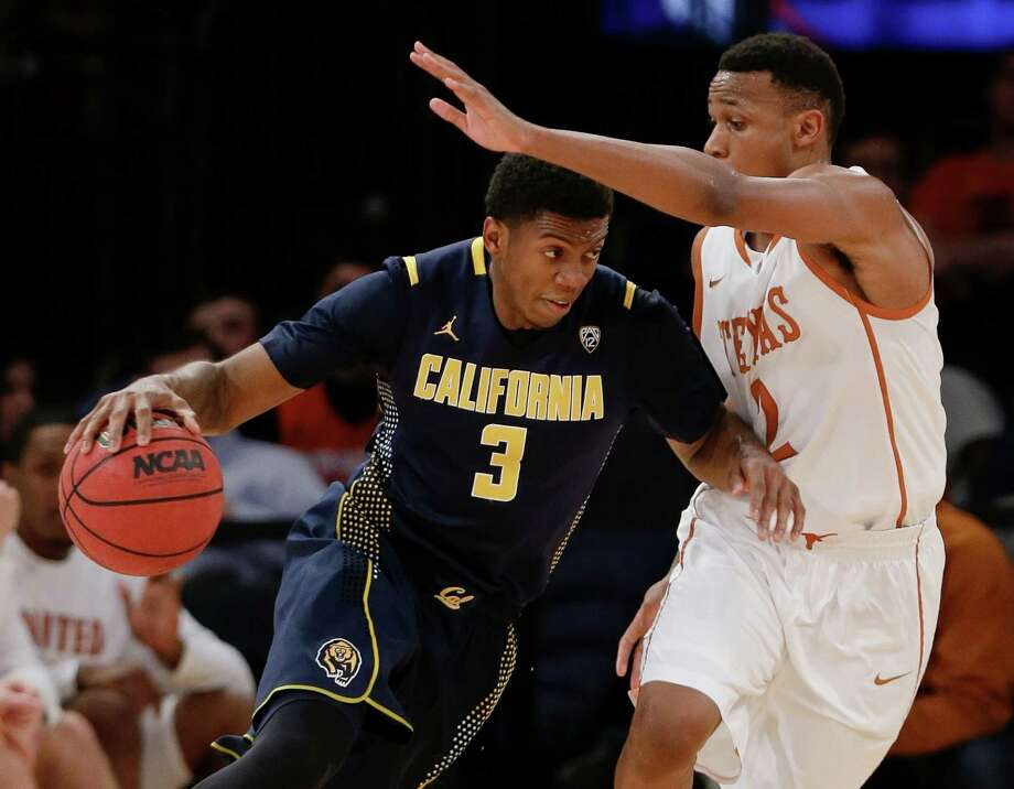 Cal's Tyrone Wallace, left, discovers firsthand why Demarcus Holland is considered UT's top on-ball defender. The Horns increasingly employ a 2-3 zone. Photo: Frank Franklin, STF / AP