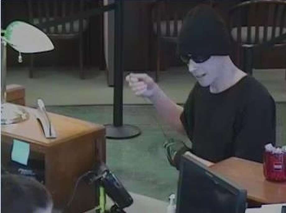 The suspect in a Petaluma bank robbery is described as a white man wearing a black knit cap, sunglasses, black T-shirt, khaki pants and white shoes. Photo: Courtesy / Petaluma Police Department / ONLINE_YES