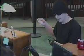 The suspect in a Petaluma bank robbery is described as a white man wearing a black knit cap, sunglasses, black T-shirt, khaki pants and white shoes.