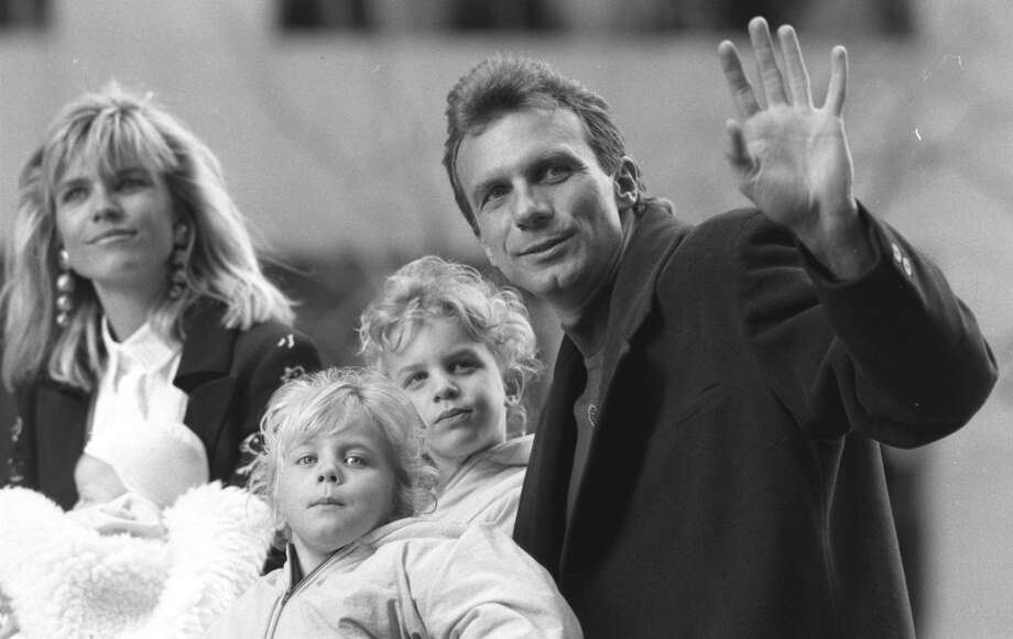 Joe Montana and family during the victory parade down Market St. in San Francisco in 1990 after the third 49ers Super Bowl win. Photo: Brant Ward / The Chronicle