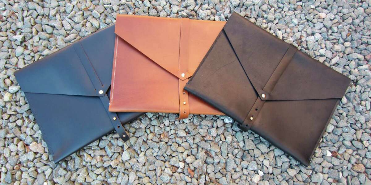 The Ego bag, $250, comes in cognac brown, soft black and navy/brown.