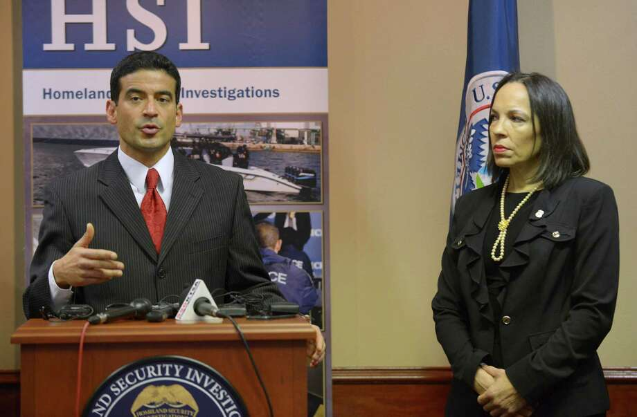 District Attorney Nico LaHood speaks about human trafficking as Special Agent in Charge Janice Ayala of Homeland Security  stands by Friday. Photo: Billy Calzada /San Antonio Express-News / San Antonio Express-News
