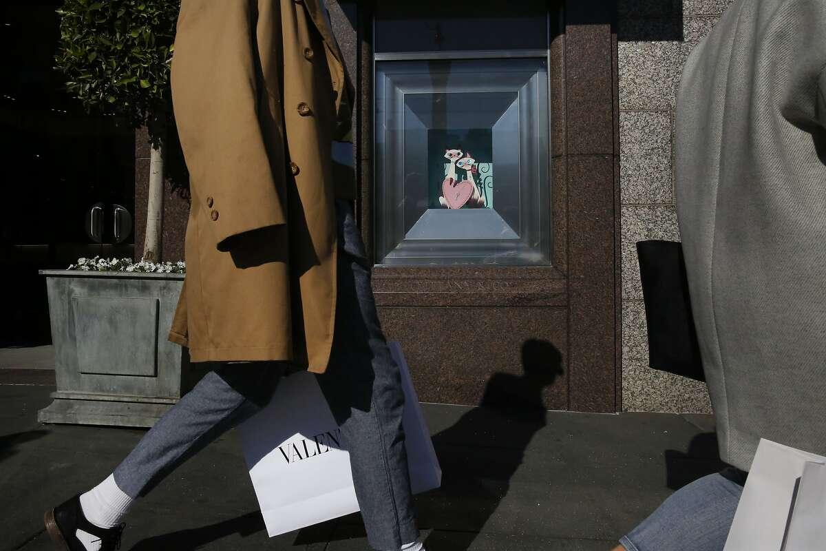 Pedestrians walk past Tiffany & Co. Jan. 21, 2015 in San Francisco, Calif.