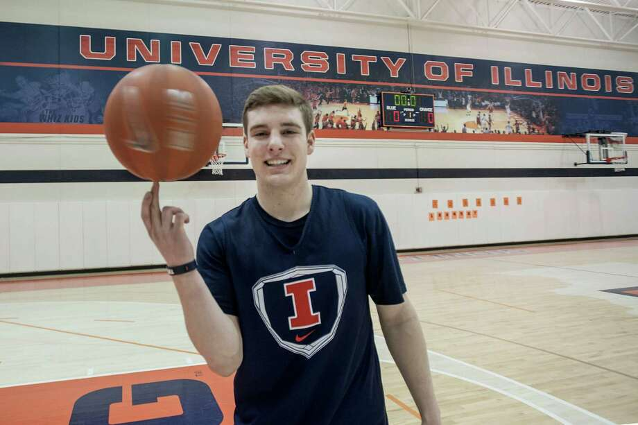 Ryan Schmidt, a student-manager for the University of Illinois basketball team, spins a ball after practice at Ubben Basketball Complex in Champaign, Ill., Friday Jan. 23, 2015. The injury situation at Illinois has come to this: Coach John Groce has added team manager Ryan Schmidt to the roster. After almost four full seasons of working with towels, water bottles and the stools players sit on during timeouts, the 6-foot senior guard will wear No. 14 on Saturday when Illinois travels to Minnesota (12-8, 1-6 Big Ten).  (AP Photo/The News-Gazette, Rick Danzl)  MANDATORY CREDIT Photo: Rick Danzl, MBR / The News-Gazette