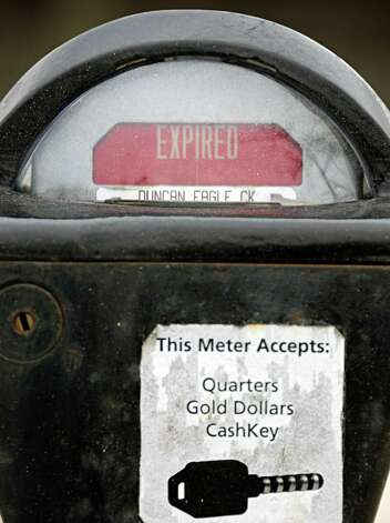 An old style parking meter on Madison Avenue Friday Jan. 23, 2015, in Albany, NY.  (John Carl D'Annibale / Times Union) Photo: John Carl D'Annibale / 00030337A
