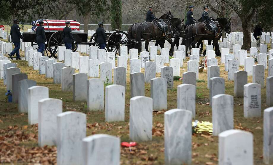 The remains of Army Sgt. Gilberto Lopez Sanchez are carried to a final resting place at Fort Sam Houston National Cemetery. Photo: Bob Owen /San Antonio Express-News / © 2015 San Antonio Express-News