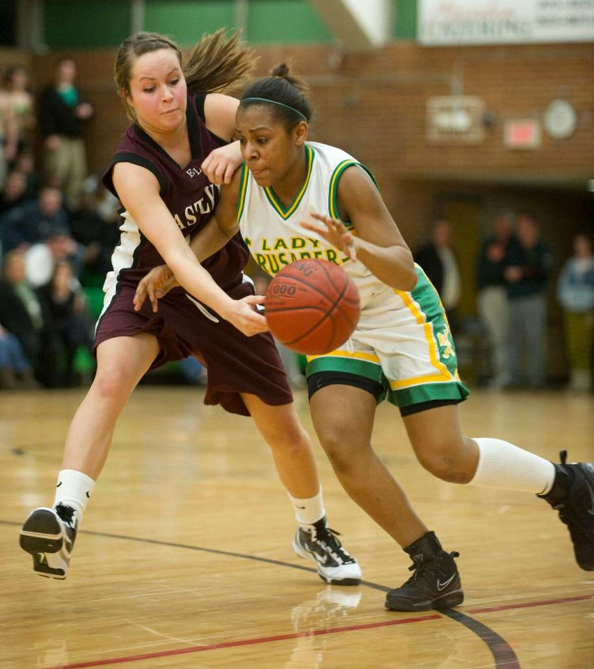 East Lyme's Michelle Lagrotteria, left, tips the ball from Trinity's Jovan Kingwood's hands during the the first round of the 2010 CIAC Class L girls basketball tournament at Trinity Catholic High School in Stamford, Conn. on Monday, March 1, 2010.