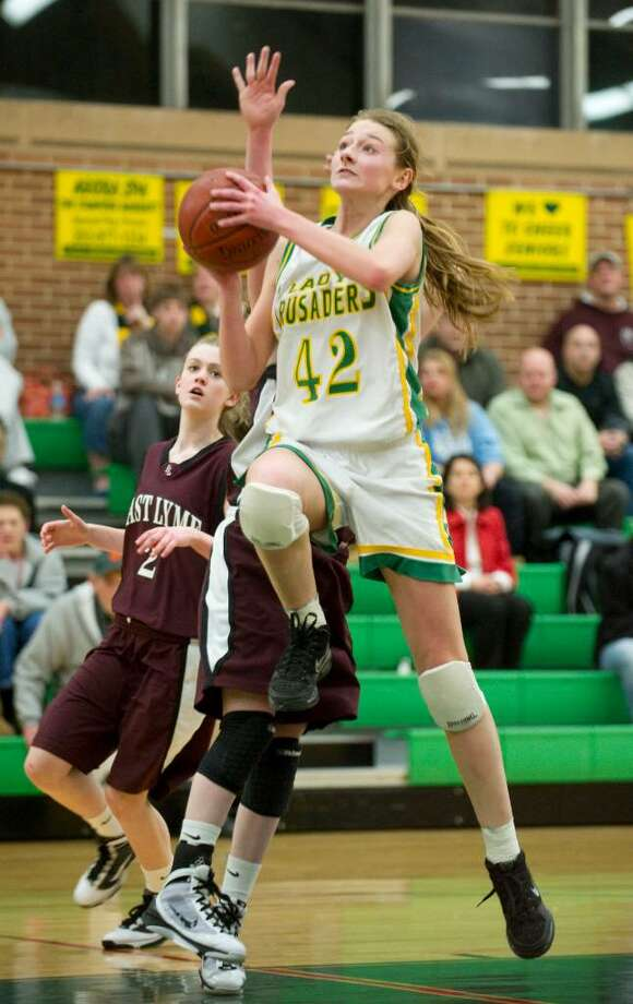 Trinity's Mackenzie Griffin shoots during the the first round of the 2010 CIAC Class L girls basketball tournament at Trinity Catholic High School in Stamford, Conn. on Monday, March 1, 2010. Photo: Chris Preovolos / Stamford Advocate