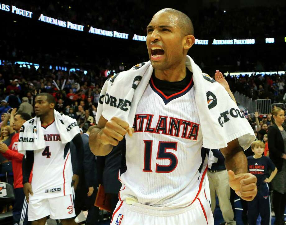 Center Al Horford led the cheers after the Hawks beat the Thunder to seal their franchise-record 15th straight win. Photo: Curtis Compton, MBR / Atlanta Journal-Constitution