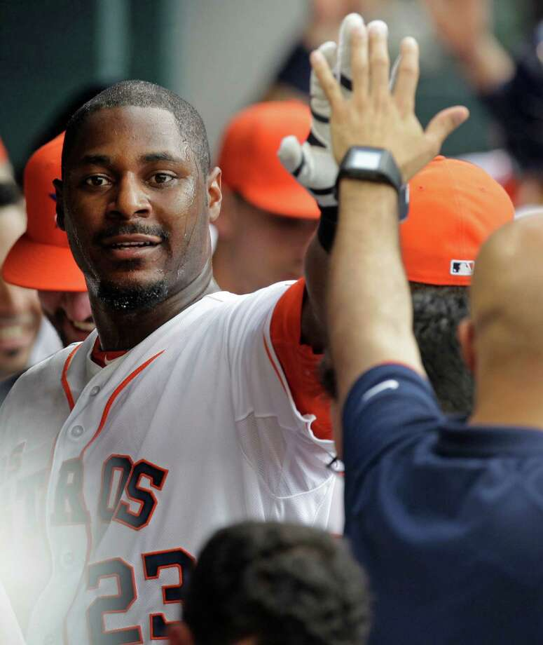 Astros teammates say veteran slugger Chris Carter is on the quiet side but accessible and willing to share his knowledge. Photo: Melissa Phillip, Staff / © 2014  Houston Chronicle