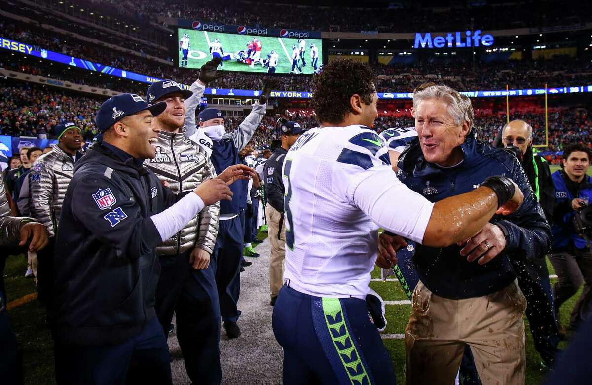 Seahawks coach Pete Carroll turns after Gatorade was dumped on him by quarterback Russell Wilson during Super Bowl XLVIII Sunday, Feb. 2, 2014, at MetLife Stadium in New Jersey. The Seahawks beat the Broncos 43 - 8 to clinch the championship.