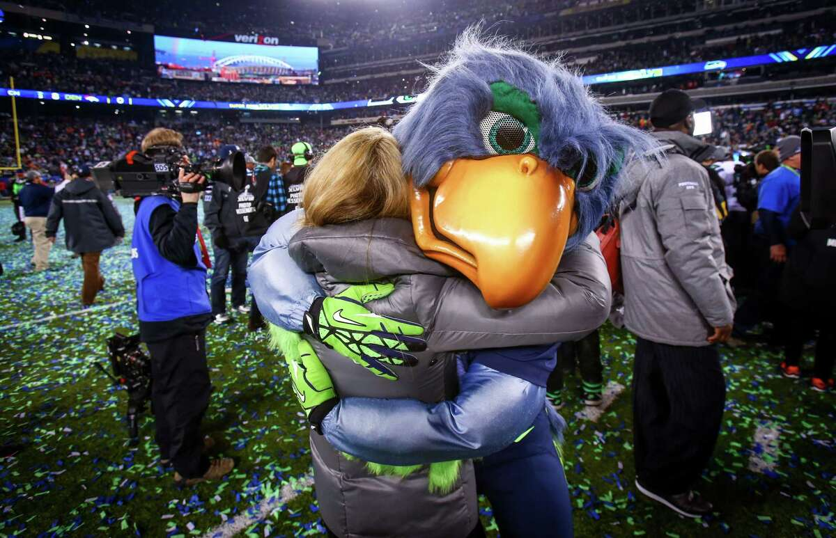 The former Seahawks mascot is hugged after a victory over the Broncos during Super Bowl XLVIII Sunday, Feb. 2, 2014, at MetLife Stadium in New Jersey. The Seahawks beat the Broncos 43 - 8 to clinch the championship.