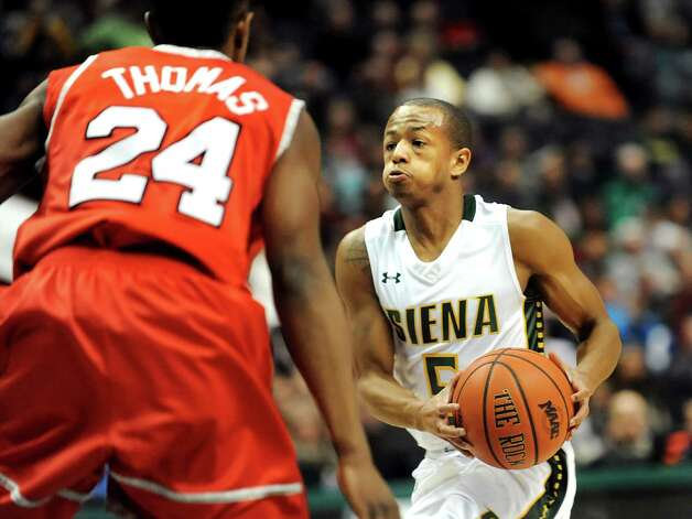 Siena's Evan Hymes, right, heads for the hoop as Marist's Manny Thomas defends during their basketball game on Friday, Jan. 23, 2015, at Times Union Center in Albany, N.Y. (Cindy Schultz / Times Union) Photo: Cindy Schultz / 00030241A