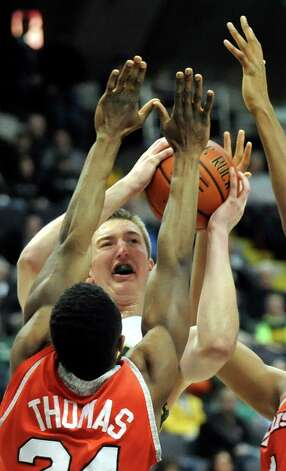Siena's Willem Brandwijk, center, runs into heavy traffic during their basketball game on Friday, Jan. 23, 2015, at Times Union Center in Albany, N.Y. (Cindy Schultz / Times Union) Photo: Cindy Schultz / 00030241A