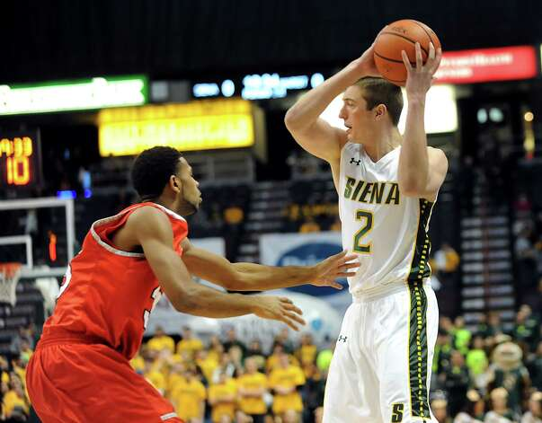 Siena's Willem Brandwijk, right, looks to pass as Marist's Phillip Lawrence defends during their basketball game on Friday, Jan. 23, 2015, at Times Union Center in Albany, N.Y. (Cindy Schultz / Times Union) Photo: Cindy Schultz / 00030241A