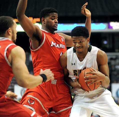 Siena's Lavon Long, right, tries to muscle past Marist's Kentrall Brooks during their basketball game on Friday, Jan. 23, 2015, at Times Union Center in Albany, N.Y. (Cindy Schultz / Times Union) Photo: Cindy Schultz / 00030241A