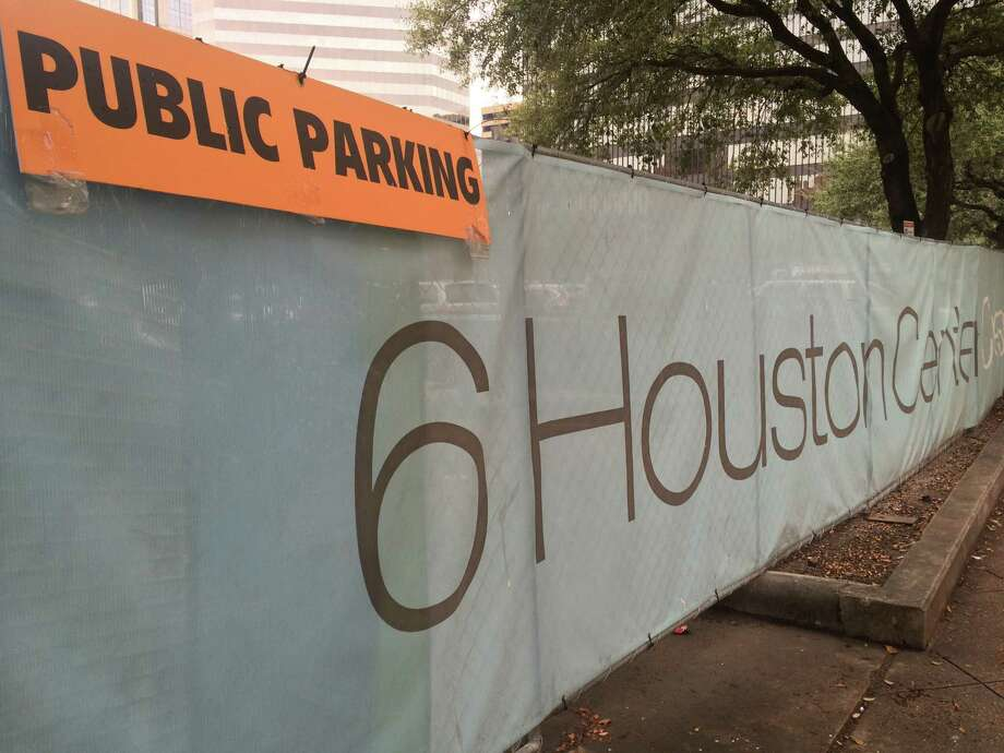 A construction fence promoting Six Houston Center on the block bounded by Walker, Rusk, Caroline and San Jacinto. Photo: Nancy Sarnoff