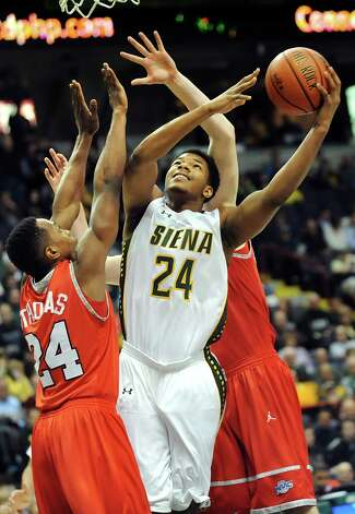Siena's Lavon Long, center, gets the squeeze as he goes to the hoop against Marist during their basketball game on Friday, Jan. 23, 2015, at Times Union Center in Albany, N.Y. (Cindy Schultz / Times Union) Photo: Cindy Schultz / 00030241A