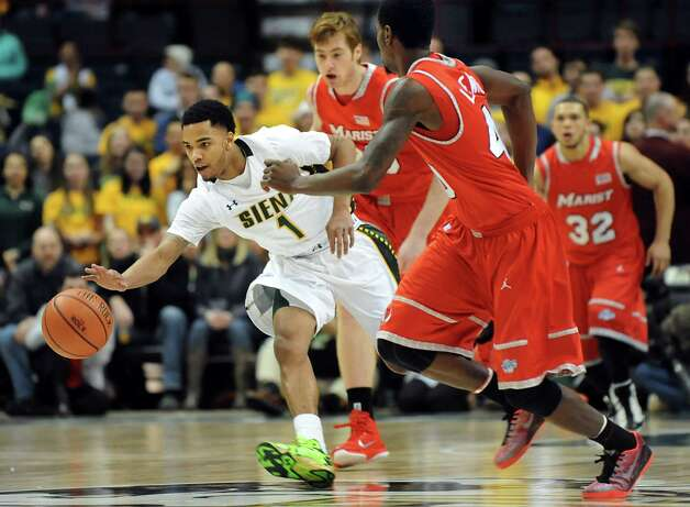 Siena's Marquis Wright, left, and Marist's Chavaughn Lewis chase a loose ball during their basketball game on Friday, Jan. 23, 2015, at Times Union Center in Albany, N.Y. (Cindy Schultz / Times Union) Photo: Cindy Schultz / 00030241A