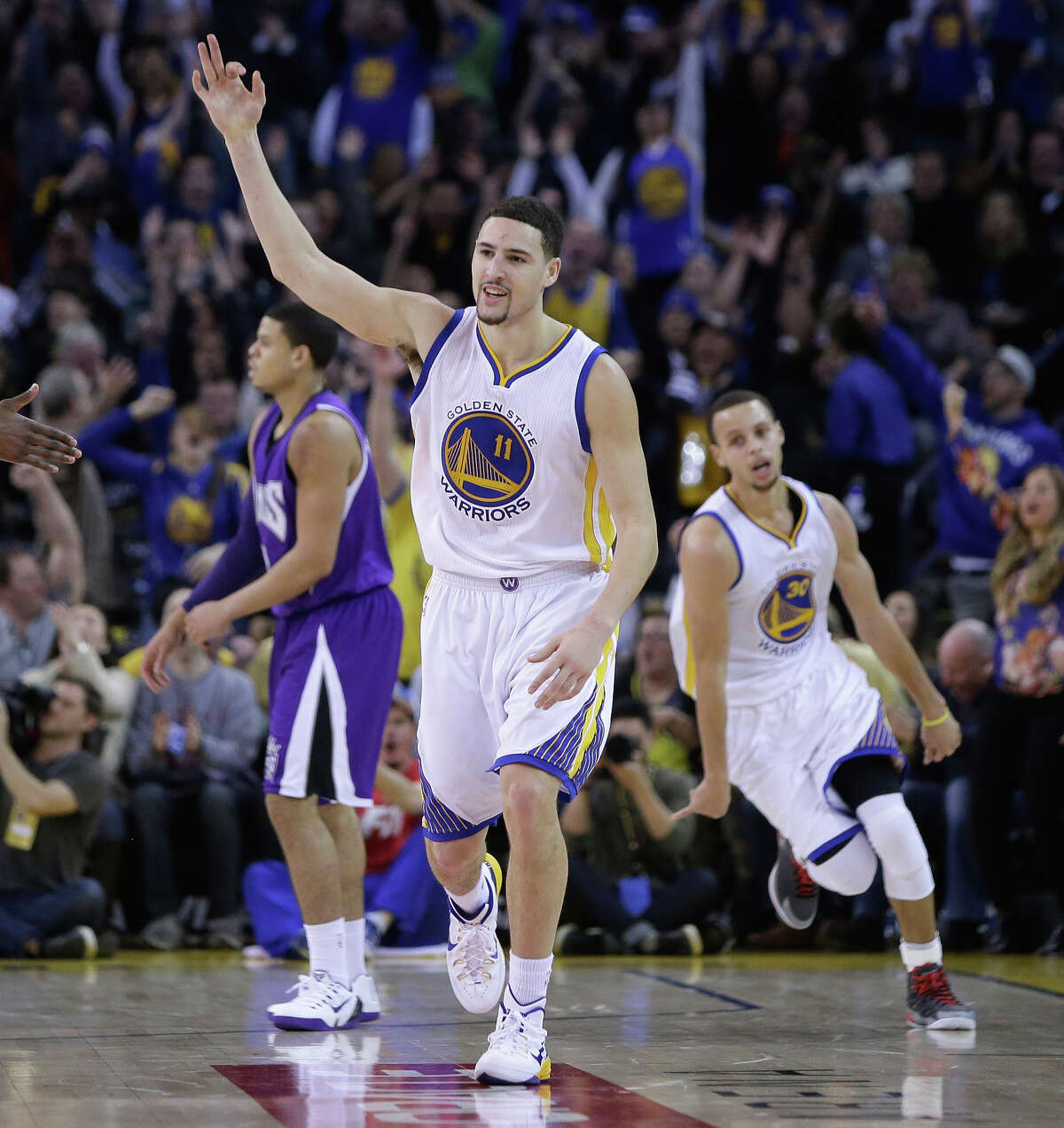 The Warriors' Klay Thompson holds up his hot hand after one of his nine three-pointers in the third quarter.