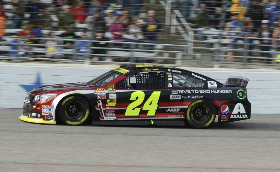 Jeff Gordon (24) drives through turn four during the NASCAR Sprint Cup Series auto race at Texas Motor Speedway in Fort Worth, Texas, Sunday, Nov. 2, 2014. (AP Photo/Larry Papke) Photo: Larry Papke / Associated Press / FR58581 AP