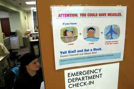 Measles literature seen at Kaiser's emergency department check-in at Redwood City, Calif., on Friday, January 23, 2015.  With the Disneyland measles outbreak expected to grow, Kaiser prepares patients with advice on what to do if someone is sick.