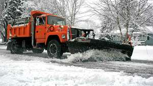A snowplow clears Judd St. in Fairfield, Conn. on Saturday, Jan. 24, 2015. After an overnight accumulation, the snow transitioned to rain by late morning.