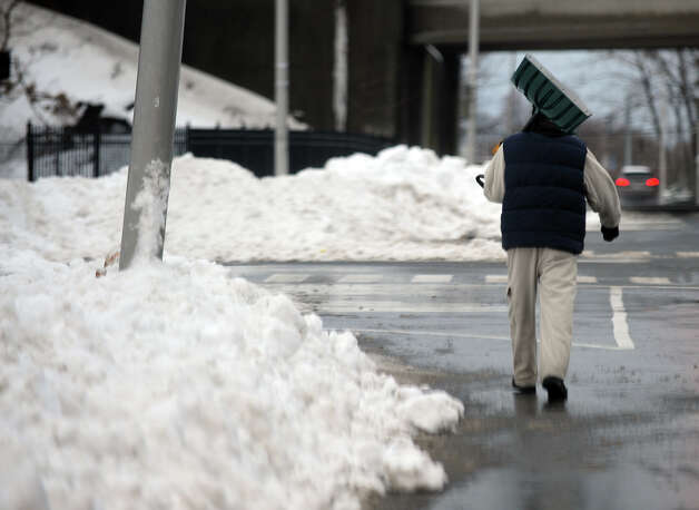 "The city of Bridgeport has seen an increase in the number of trip and fall cases. ""Weather is the basis for a lot of these claims,"" said Brett Broesder, a spokesman for Mayor Bill Finch's office. ""It's worth noting that 2013 was an extraordinarily difficult winter, which may have resulted in more claims in 2014."" Photo: Christian Abraham / Connecticut Post"