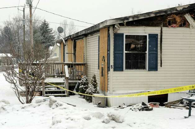 The scene of a fatal fire in a tailer at D&R Village on Saturday Jan. 24, 2015 in Halfmoon , N.Y. (Michael P. Farrell/Times Union) Photo: Michael P. Farrell