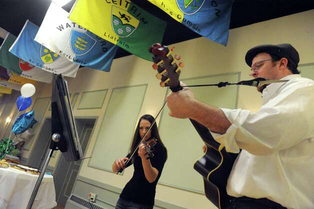Kelly Deihl and John Halvorsen perform Irish tunes during a fundraiser for the Albany Marching Falconsa€™ efforts to raise funds for their upcoming trip to Ireland at the Albany Ancient Order of Hibernians Hall on Saturday Jan. 24, 2015 in Albany, N.Y. The group is heading to Ireland in March and will perform in the St. Patricka€™s Day parade in Dublin. To contribute visit http://www.gofundme.com/dil98s. You also can send a check made out to Albany Marching Falcons, c/o Bryan Cady, Albany School of Humanities, 108 Whitehall Road, Albany, NY 12209. (Michael P. Farrell/Times Union) Photo: Michael P. Farrell / 00030319A