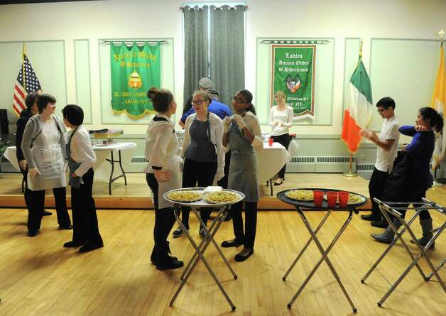 Members of the band assemble to serve part treats during a fundraiser for the Albany Marching Falcons' trip to Ireland at the Albany Ancient Order of Hibernians Hall on Saturday Jan. 24, 2015 in Albany, N.Y. (Michael P. Farrell/Times Union archive) Photo: Michael P. Farrell / 00030319A
