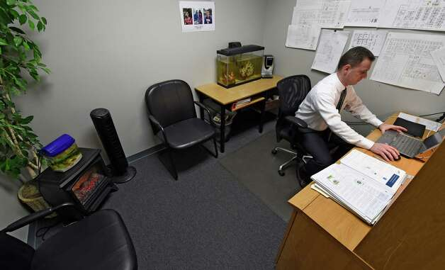 Gary F. Nelson, director of information technology sales and marketing sits in his office surrounded by stress reducing items Thursday morning Jan. 22, 2015 at the Repeat Business Systems Co. in Colonie, N.Y.  (Skip Dickstein/Times Union) Photo: SKIP DICKSTEIN / 00030286A