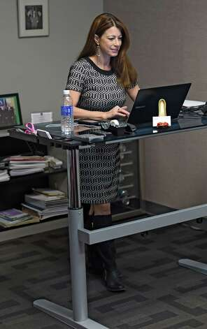 CEO Dawn Abbuhl stands at her work station Thursday morning Jan. 22, 2015 at the Repeat Business Systems Co. in Colonie, N.Y.  (Skip Dickstein/Times Union) Photo: SKIP DICKSTEIN / 00030286A