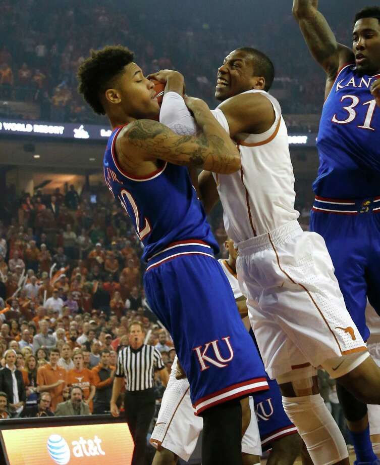 AUSTIN, TX - JANUARY 24: Cameron Ridley #55 of the Texas Longhorns fights for the ball with Kelly Oubre Jr. #12 of the Kansas Jayhawks at the Frank Erwin Center on January 24, 2015 in Austin, Texas. Photo: Chris Covatta, Getty Images / 2015 Getty Images