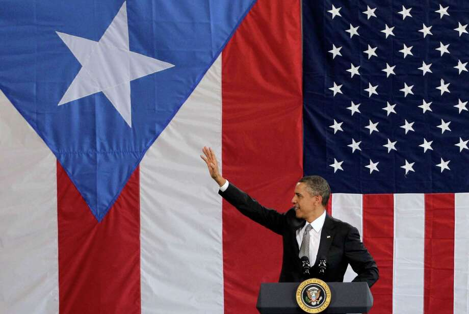 President Barack Obama traveled to Puerto Rico in 2011, marking the first visit to the country by a sitting U.S. president since John F. Kennedy. Photo: Brennan Linsley, STF / AP