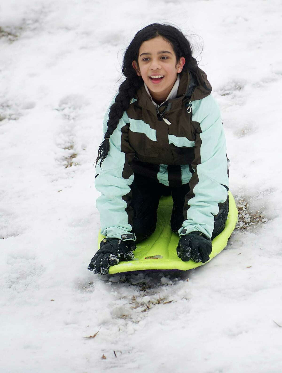Vanessa Luna, 11, sleds at Cummings Park in Stamford, Conn., on Saturday, January 24, 2015.