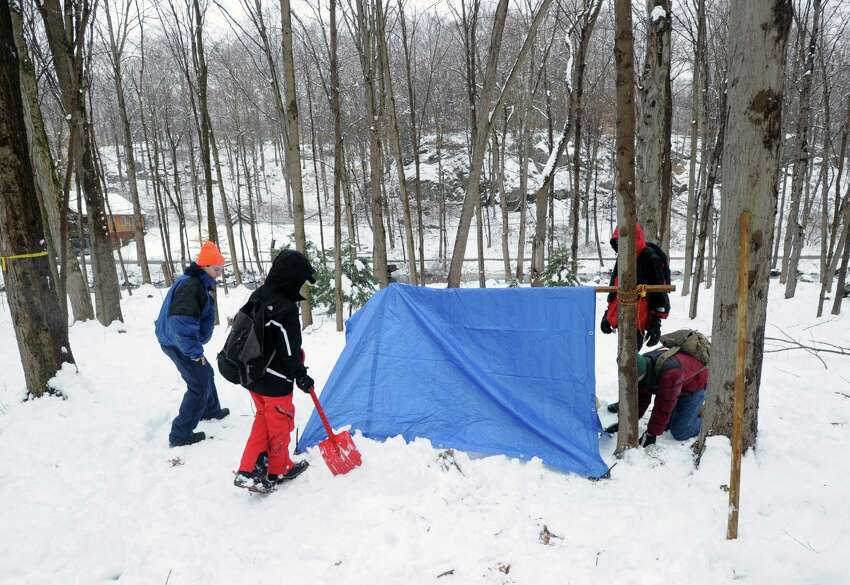 Boy Scouts from Troop 10 of Cos Cob build a survival shelter in the snow during the annual Greenwich Boy Scouts Klondike Derby at the Ernest Thompson Seton Reservation in Greenwich, Conn., Saturday, Jan. 24, 2015. The snow provided the perfect environment to test the survival skills of Greenwich Boy Scout Troops and Boy Scouts from the Algonquin District of the Westchester-Putnam Council. Each troop used a Klondike dog sled loaded with their personal and patrol equipment as they competed at various outdoor survival skills stations.