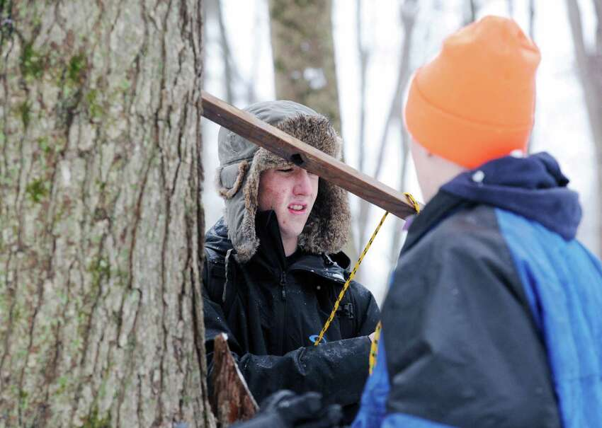 At center, Boy Scout Jack Seavey, 17, Troop 10 of Cos Cob, uses rope to make a survival shelter with other Troop 10 Boy Scouts during the annual Greenwich Boy Scouts Klondike Derby at the Ernest Thompson Seton Reservation in Greenwich, Conn., Saturday, Jan. 24, 2015. The snow provided the perfect environment to test the survival skills of Greenwich Boy Scout Troops and Boy Scouts from the Algonquin District of the Westchester-Putnam Council. Each troop used a Klondike dog sled loaded with their personal and patrol equipment as they competed at various outdoor survival skills stations.