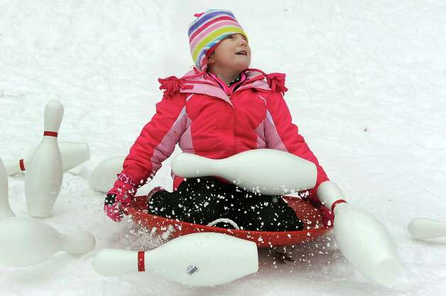 Allie Leonard, 4, of Selkirk slides into bowling pins and hits a strike at snow bowling during the 30th annual Winter Festival on Saturday, Jan. 24, 2015, at Grafton Lakes State Park in Grafton, N.Y. The event also featured ice fishing, hockey, hikes, games for kids and a polar plunge. (Cindy Schultz / Times Union) Photo: Cindy Schultz / 00030277A