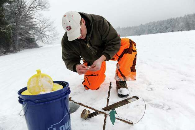 Woody Jackson of Latham sets a tip up for ice fishing during the 30th annual Winter Festival on Saturday, Jan. 24, 2015, at Grafton Lakes State Park in Grafton, N.Y. Jackson said he hooked a 12-inch brown trout at the crack of dawn. The event also featured hockey, hikes, games for kids and a polar plunge. (Cindy Schultz / Times Union) Photo: Cindy Schultz / 00030277A
