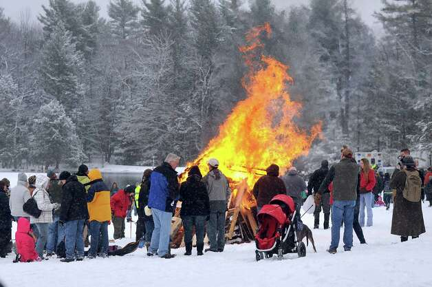 Festival attendees warm up by a blazing bonfire during the 30th annual Winter Festival on Saturday, Jan. 24, 2015, at Grafton Lakes State Park in Grafton, N.Y. (Cindy Schultz / Times Union) Photo: Cindy Schultz / 00030277A