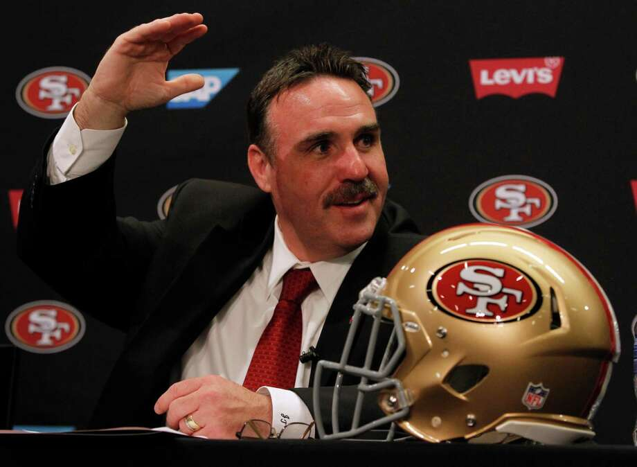 In his new role, Niners head coach Jim Tomsula will have a tough act to follow after Jim Harbaugh's successful run. Photo: Paul Chinn / The Chronicle / ONLINE_YES