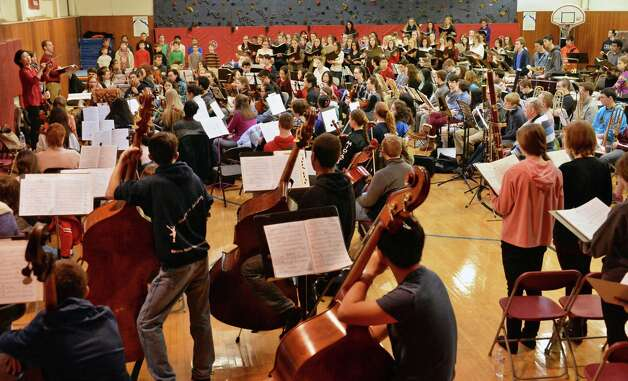 """Music Director Helen Cha-Pyo, far left, conducts a rehearsal of """"Carmina Burana"""" featuring around 350 student musicians, including four high school choirs and the Empire State Youth Orchestra at the Brown School Saturday Jan. 24, 2015, in Schenectady, NY. The work will be performed at 3:00 pm Sunday, January 25 at the Palace Theatre in Albany.    (John Carl D'Annibale / Times Union) Photo: John Carl D'Annibale / 00030231A"""