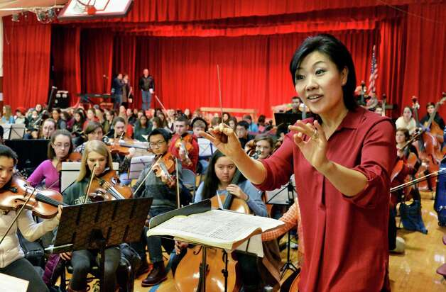 """Music Director Helen Cha-Pyo conducts a rehearsal of """"Carmina Burana"""" featuring around 350 student musicians, including four high school choirs and the Empire State Youth Orchestra at the Brown School Saturday Jan. 24, 2015, in Schenectady, NY.  The work will be performed at 3:00 pm Sunday, January 25 at the Palace Theatre in Albany.   (John Carl D'Annibale / Times Union) Photo: John Carl D'Annibale / 00030231A"""