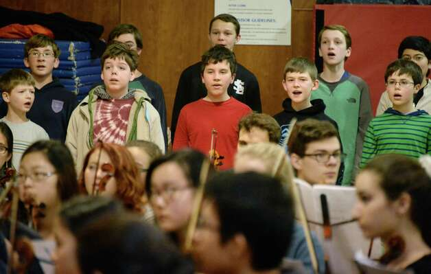 """Members of the Cathedral of All Saints Boyschoir, top, during a rehearsal of """"Carmina Burana"""" featuring around 350 student musicians, including four high school choirs and the Empire State Youth Orchestra at the Brown School Saturday Jan. 24, 2015, in Schenectady, NY.  The work will be performed at 3:00 pm Sunday, January 25 at the Palace Theatre in Albany.   (John Carl D'Annibale / Times Union) Photo: John Carl D'Annibale / 00030231A"""