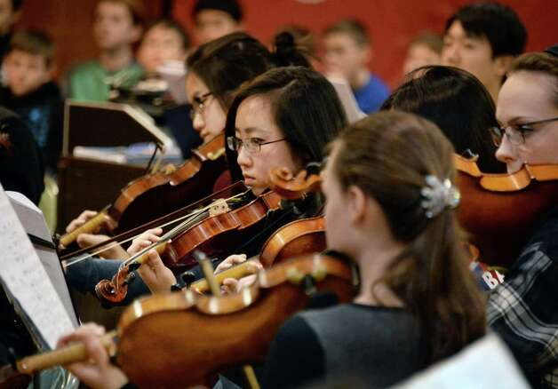 """The Empire State Youth Orchestra rehearses """"Carmina Burana"""" featuring around 350 student musicians, including four high school choirs at the Brown School Saturday Jan. 24, 2015, in Schenectady, NY. The work will be performed at 3:00 pm Sunday, January 25 at the Palace Theatre in Albany.    (John Carl D'Annibale / Times Union) Photo: John Carl D'Annibale / 00030231A"""