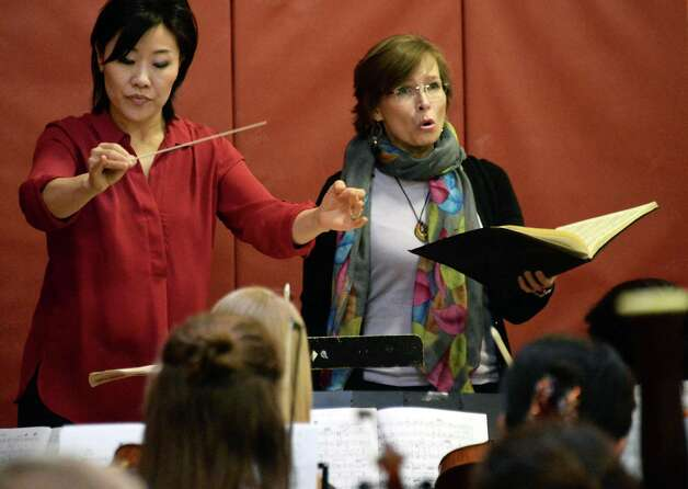 """Music Director Helen Cha-Pyo, left, and guest soprano Sharla Nafziger of NYC during a rehearsal of """"Carmina Burana"""" featuring around 350 student musicians, including four high school choirs and the Empire State Youth Orchestra at the Brown School Saturday Jan. 24, 2015, in Schenectady, NY.  The work will be performed at 3:00 pm Sunday, January 25 at the Palace Theatre in Albany.   (John Carl D'Annibale / Times Union) Photo: John Carl D'Annibale / 00030231A"""