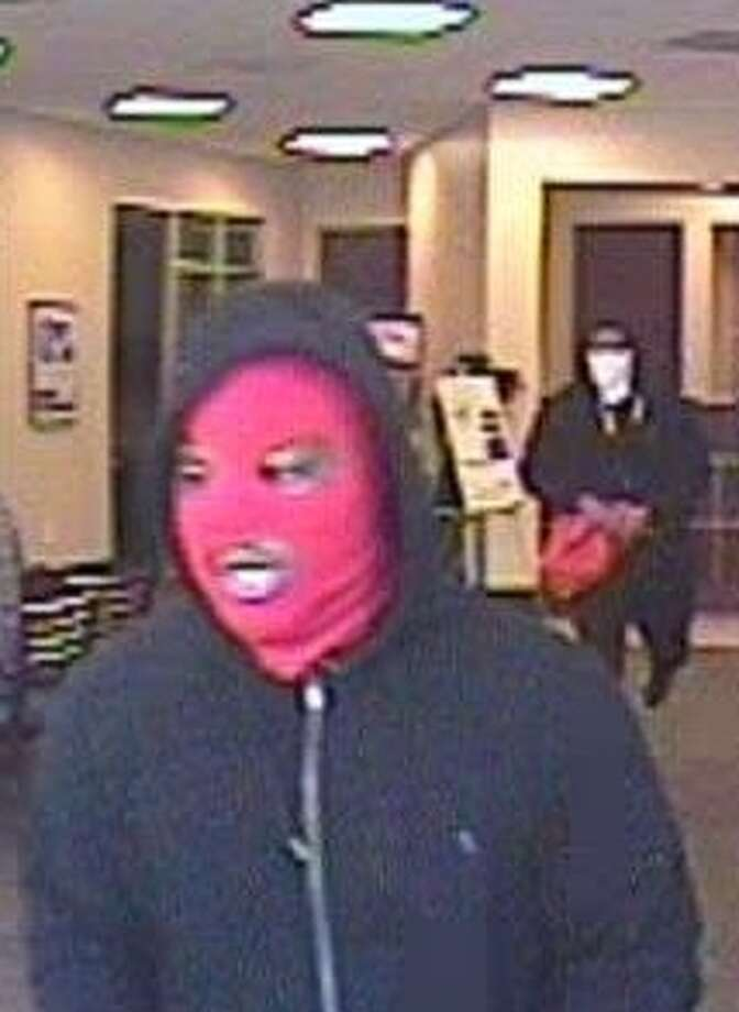 The FBI is releasing photographs of armed bank robbers who took over a busy City Centre bank earlier today.  Three men robbed the Amegy bank located at 800 Town and Country Boulevard, #110, in Houston, Texas. Photo: FBI