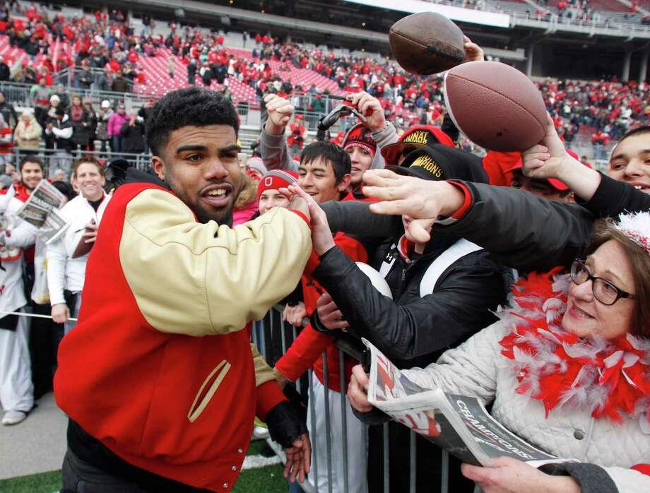 Ohio State running back Ezekiel Elliott greets fans as they celebrate a national title at Ohio Stadium. Photo: Paul Vernon / Associated Press / FR66830 AP