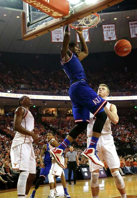 Kansas' Chris Alexander, who had 15 points, puts the finishing touches on a rousing dunk during the Jayhawks' win over Texas on Saturday in Austin. Photo: Chris Covatta, Stringer / 2015 Getty Images